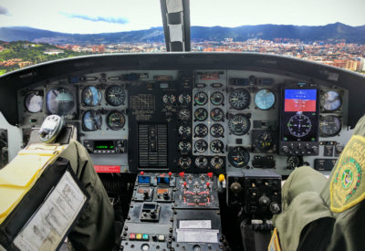 The Astronautics RoadRunner EFI onboard a Bell 212 helicopter as it flew on a demonstration flight with the Colombian National Police. The new RoadRunner EFI offers operators an easy, drop-in replacement for ADI and HSI primary flight instruments in legacy helicopters that enhances safety, reduces maintenance and replacement costs, and lowers installation downtime. Astronautics Photo