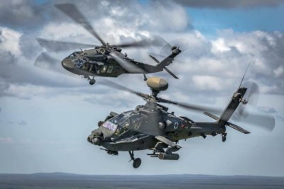 A great shot of a U.S. Army AH-64 Apache and a UH-60 Black Hawk flying in formation over Latvia. Photo submitted by Cristian Schrik/Aimhigh.nl