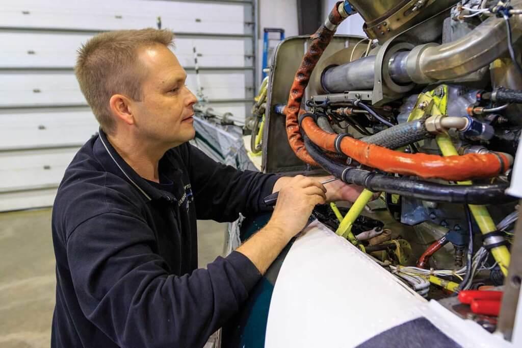 Shop foreman Ben Bruner completes an engine inspection.