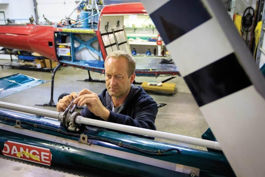 Technician Chris Samus installs a tail rotor drive shaft.