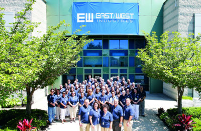 East/West company employees pose for a photo in front of the new facility. East/West Photo
