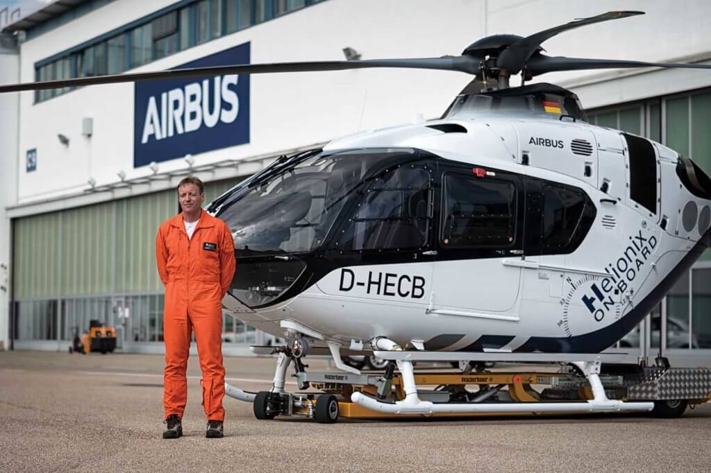 Airbus Helicopters' experimental test pilot Alexander Neuhaus stands alongside the H135 with Helionix at Airbus's facility in Donauwörth, Germany. Lloyd Horgan Photo