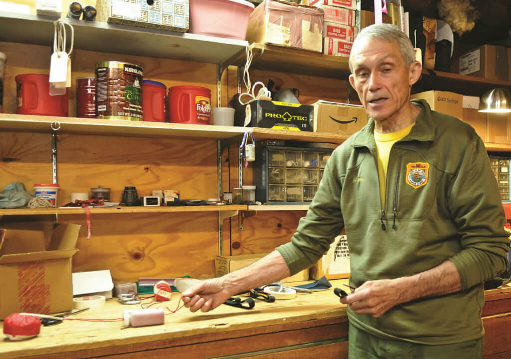 John Dill explains the beanbag system he has developed over the past 30 years in his workshop in the SAR cache at Yosemite National Park.