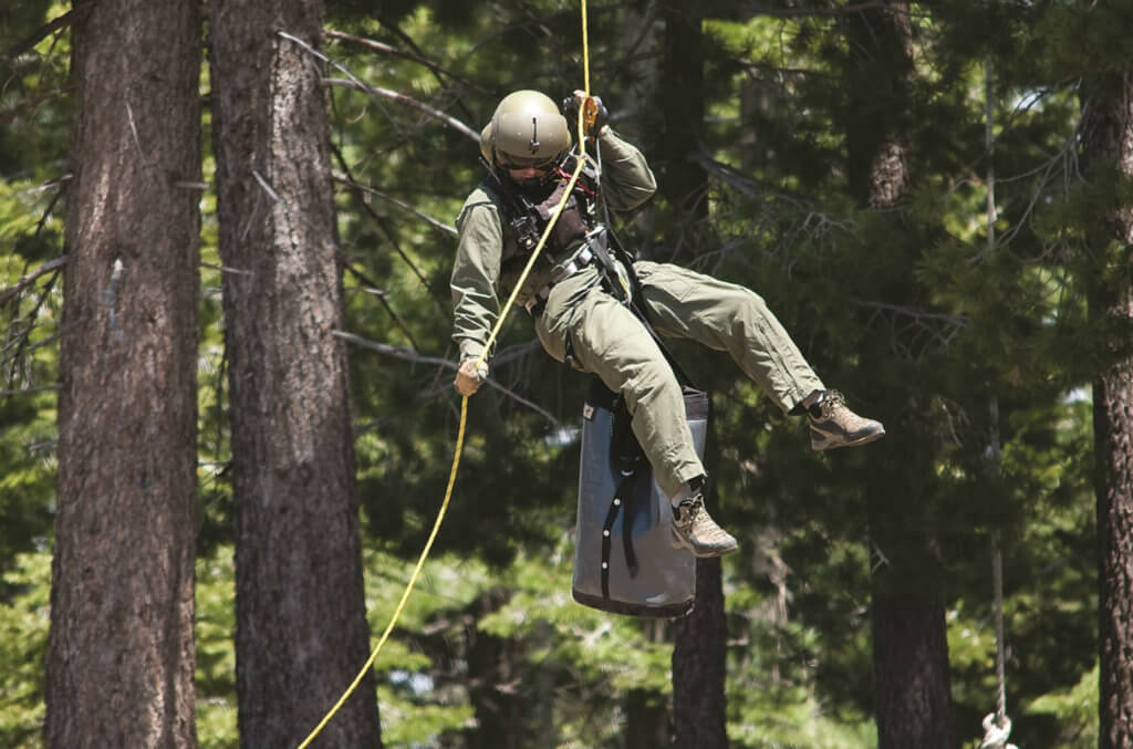 Rappel techniques are used to deliver rescuers into big trees, including the park's 200-foot redwoods