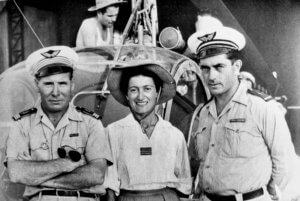 In Tan Son Hut, standing in front of a Hiller helicopter, three major players -- all pilots -- in the first helicopter medevac missions in Indochina. Left to right: Capt Alexis Santini (the first military helicopter pilot in France), Capt Valérie André and WO Henri Bartier. Philippe Boulay collection