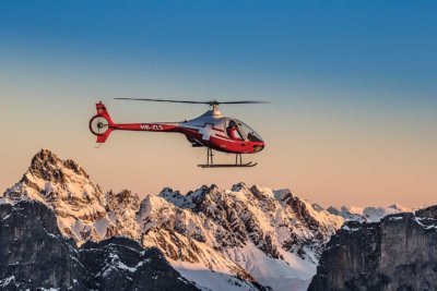 A Swiss Helicopter Guimbal Cabri G2 holds a hover in front of a typically-dramatic Swiss backdrop. The operator, formed from the amalgamation of six different companies in 2012, has become a major presence in the landlocked Central European country.