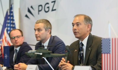 Based on this LOI, Polska Grupa Zbrojeniowa and Bell Helicopter will expand potential areas of cooperation related to Poland's future utility helicopter needs with the UH-1Y. Pictured here, vice-president of International Military Business for Bell Helicopter, Rich Harris (right), with PGZ representatives. Bell Photo