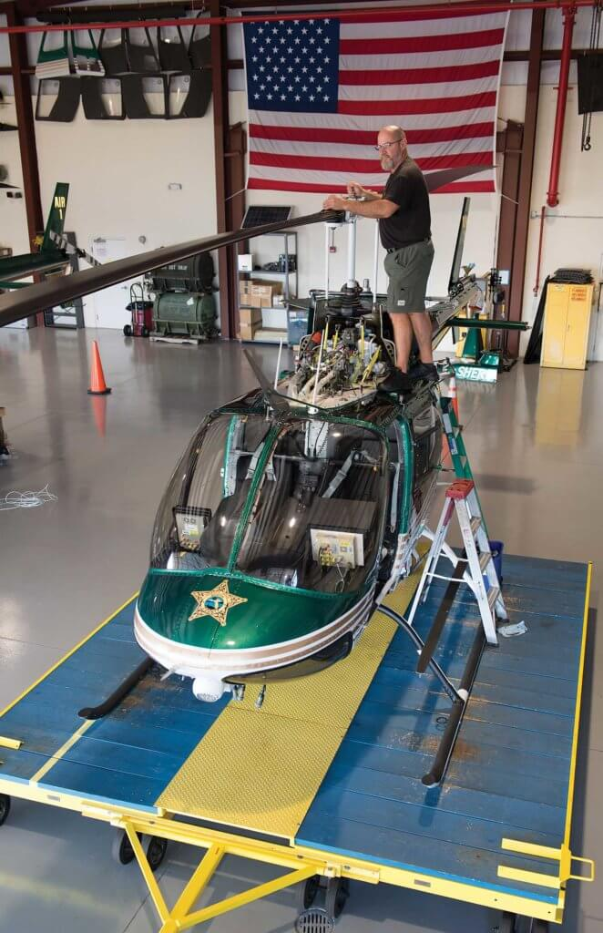 Floor and wall space in the MCSO hangar is utilized in such a way to maximize Eric Ellington's maintenance needs as well as parts and aircraft housing/storage.