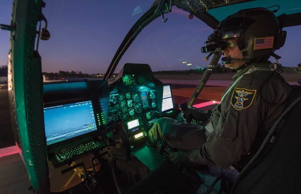 Deputy Sheriff Sean Marston preparing for an evening NVG patrol flight.