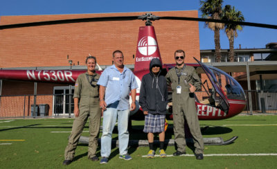 Two lucky winners of the Kings Table feast recently received a helicopter ride over their tented home by city hall over the City of Santa Ana, beaches and beyond. Revolution Aviation Photo