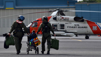 Bishop was given a flight suit and reported for duty as a rescue swimmer on July 8. USCG Photos