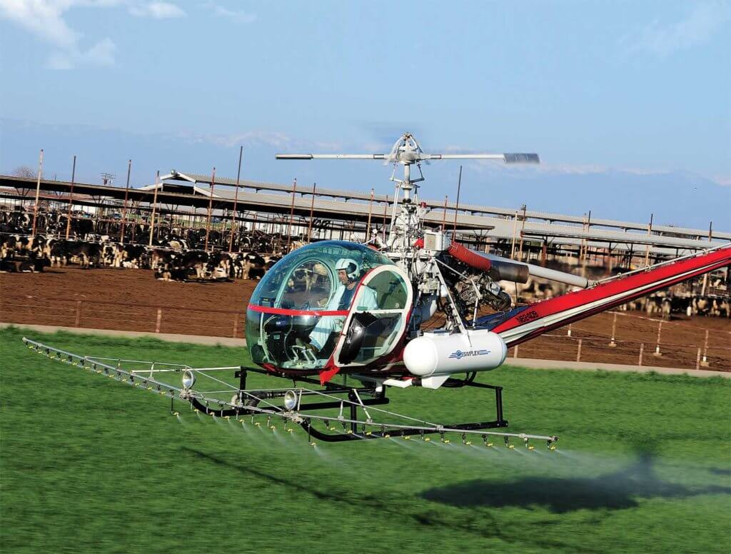 A Hiller OH-23G fitted with a Simplex spraying system. Conditions need to be just right for the spray to have the right effect. Skip Robinson Photo