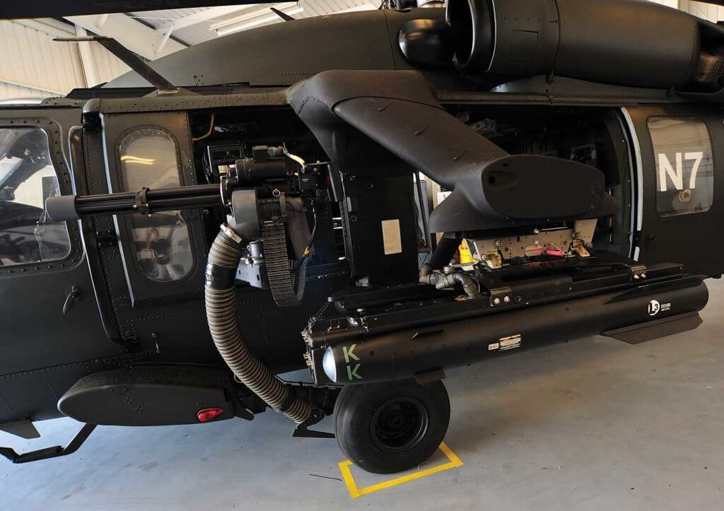 The MovieHawk is equipped with several inert weapons systems to provide it with maximum authenticity on film and TV sets. A window-mounted M134 Dillon minigun sits in front of an External Stores Support System (ESSS).