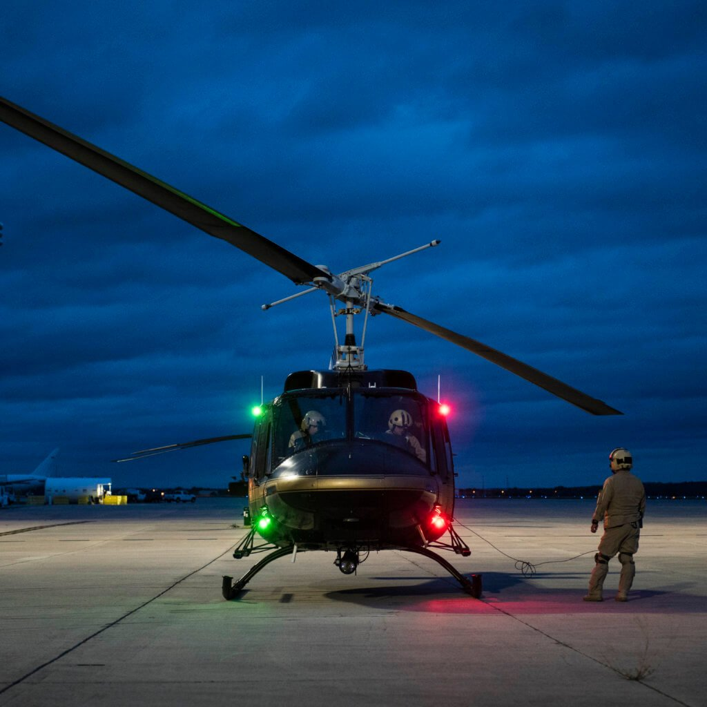 A CBP Black Hawk crew prepares to depart from a staging area in San Antonio for a rescue mission in the Houston area. CBP currently has six helicopters engaged in Hurricane Harvey relief efforts. Will Graham Photo