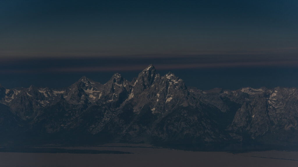 An aerial view of Wyoming's Teton Range as the solar eclipse approached totality. Lina Collado Photo / Instagram: @lina_collado