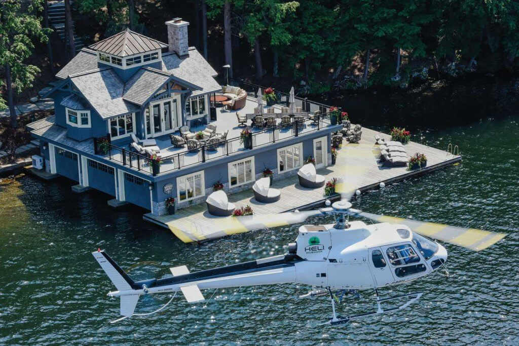 The Astar holds a hover with a spectacular boathouse in the background. Muskoka is home to some very wealthy individuals, and Heli Muskoka is carving an operational niche in supporting the construction of some of their homes.