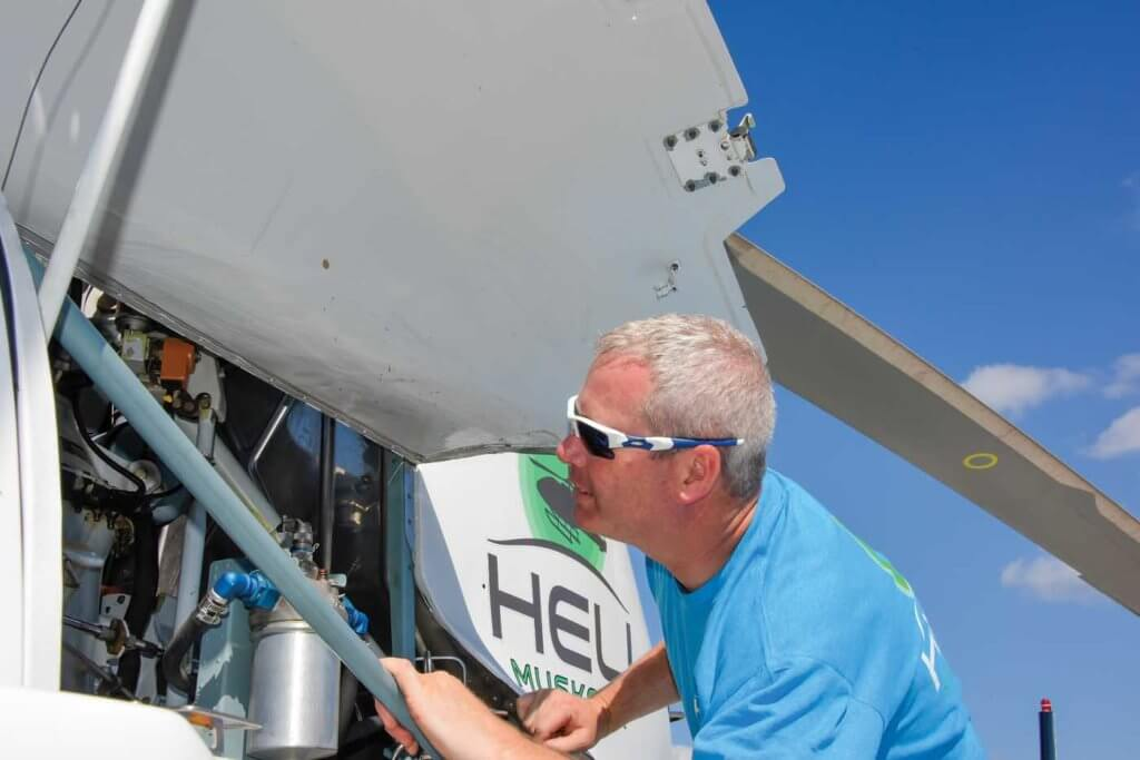 Heli Muskoka's chief pilot/operations manager Jay McMackin takes a look under the cowling.
