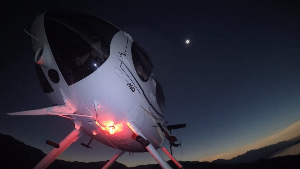 Scott Urschel of Pylon Aviation was flying near Jackson in an MD 530F during the eclipse. He captured this shot of his aircraft during totality using a GoPro camera. Scott Urschel Photo