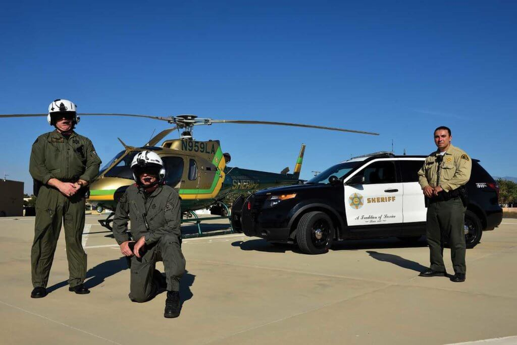 A ground unit poses with an Air 29 flight crew.