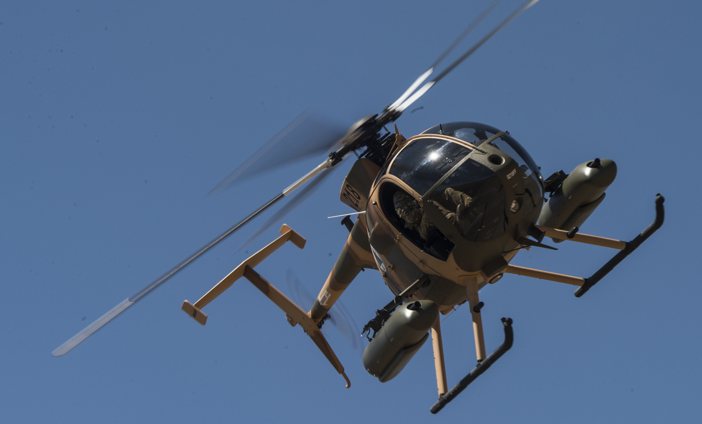 An Afghan Air Force MD 530F Cayuse Warrior helicopter maneuvers for another gun-run, during a media demonstration, in April 2015, at a training range outside of Kabul, Afghanistan. SSGT Perry Aston Photo