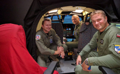 Polish Air Force helicopter pilots in the cockpit of the CAE-built SW-4 helicopter simulator now in-service for the Polish Air Force. CAE Photo