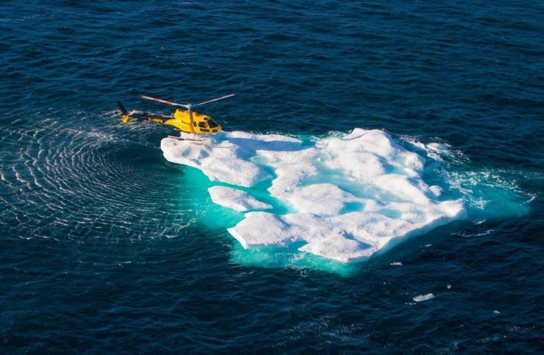A Panorama Helicopters AS350 B2 lands on an iceberg in the Arctic. Photo submitted by Instagram user @snorak88 using hashtag #verticalmag