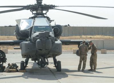 Soldiers from C Troop, 2nd Squadron, 17th U.S. Cavalry Regiment perform inspections and maintenance on an AH-64E Apache helicopter at Qayyarah West Airfield, Iraq, Sept. 2, 2017. Capt. Stephen James/U.S. Army Photo