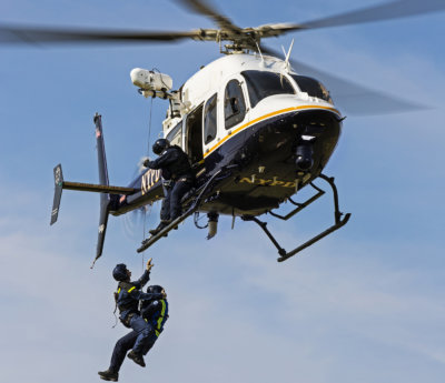 A Bell 429, operated by the NYPD, performs a hoist training mission. Able Aerospace Services now offers repair and overhaul services for the type. Able Aerospace Services Photo