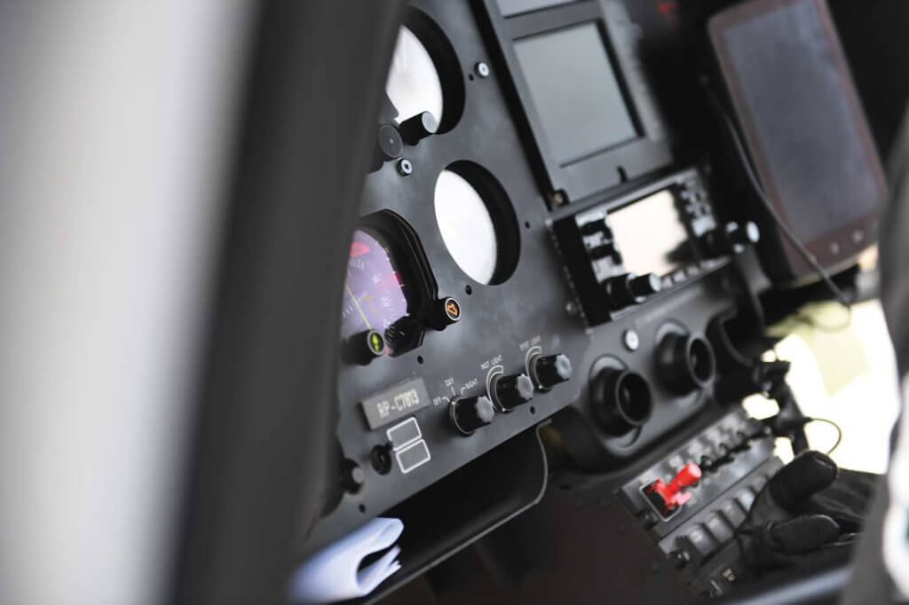 Closeup of flight instruments in cockpit.