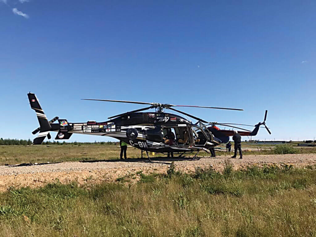 Helicopter rests on a gravel strip in Magadan, Russia.