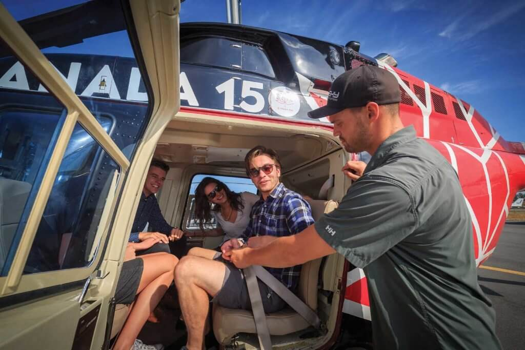 A group of tour passengers is strapped in to the back of the LongRanger. Sky Helicopter offers a range of tour packages suiting a wide range of customer budgets. Heath Moffatt Photo