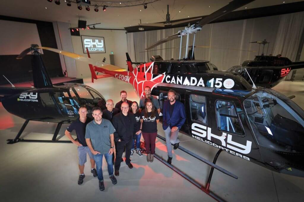 Andrew Westlund (far right) established Sky Helicopters six years ago to help transport leaders to and from downtown Vancouver. Today, the company has 10 employees and a fleet of six helicopters. Heath Moffatt Photo