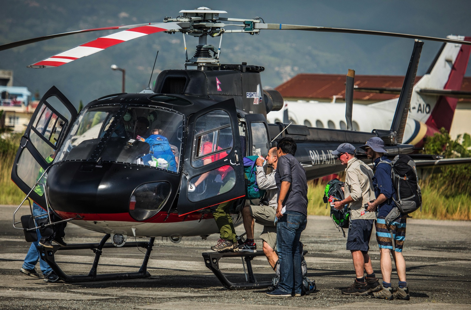 The helicopter industry in Nepal is booming thanks to a growing number of tourists, in particular high-altitude trekkers. Here, trekkers bound for Lukla board a Fishtail Air AS350 B3+ in Kathmandu in early October. Dirk Collins Photo