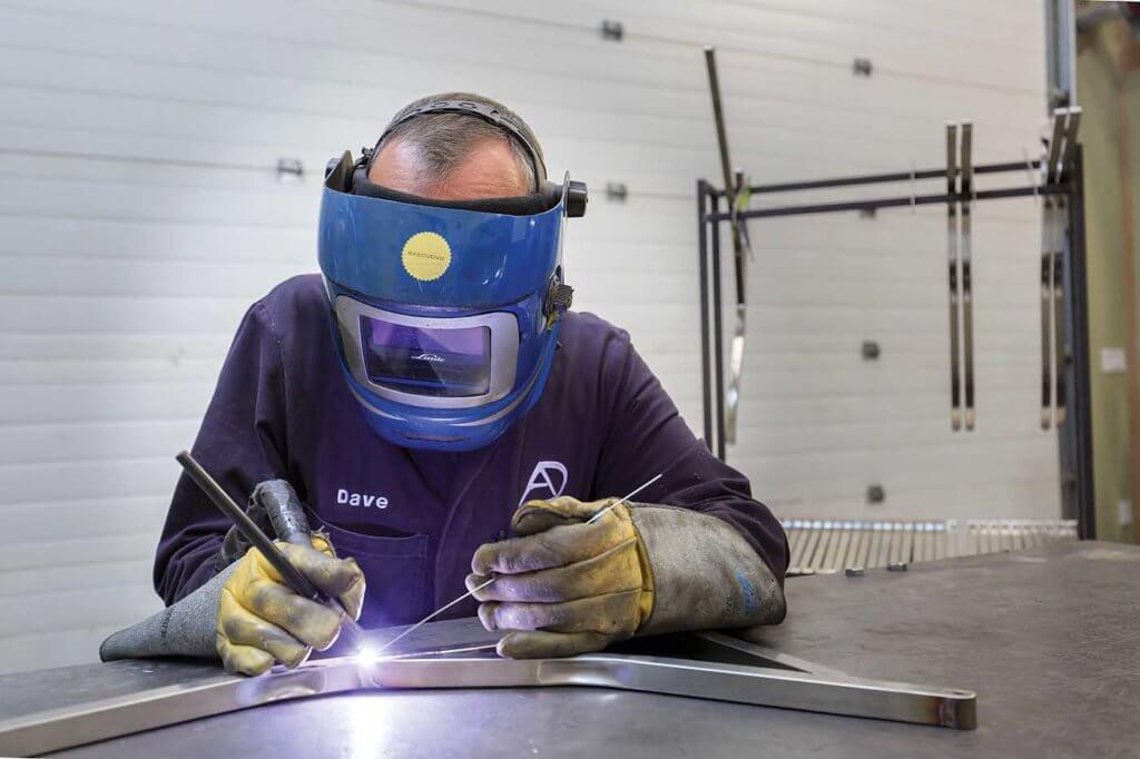Man welding in shop.