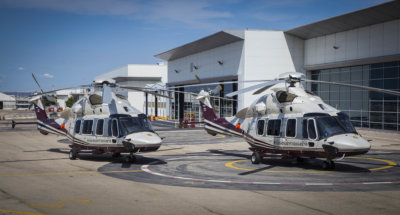 Two H175 helicopters rest on tarmac