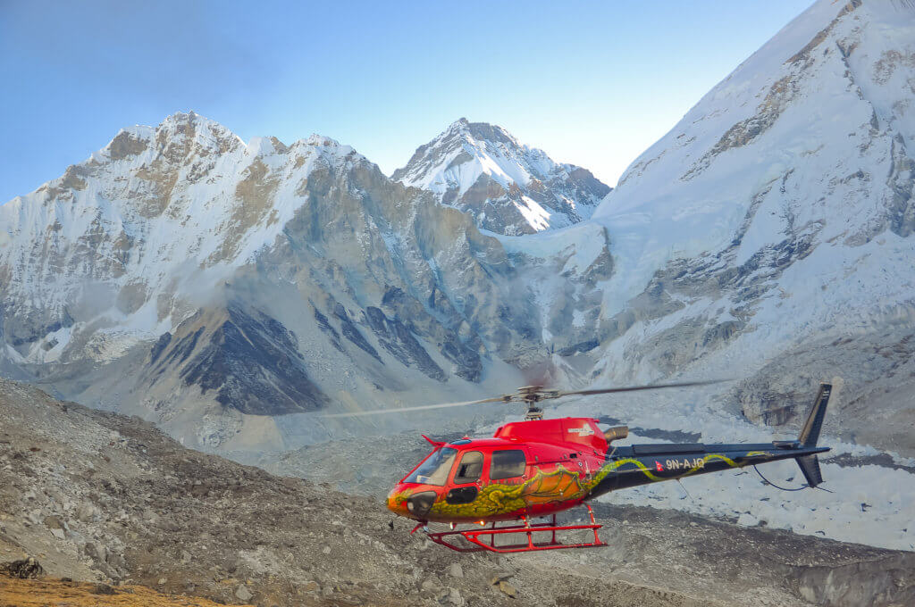 Fishtail Air pilot Eric Ridington lands above Everest Base Camp with the Khumbu Icefall visible in the background. Surya Rai Photo