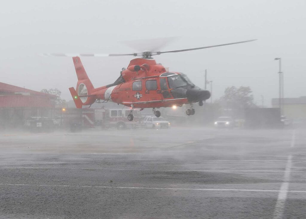 An MH-65 from USCG Air Station Mobile, Alabama, takes off from a parking lot after picking up a patient. Chris Ebdon Photo