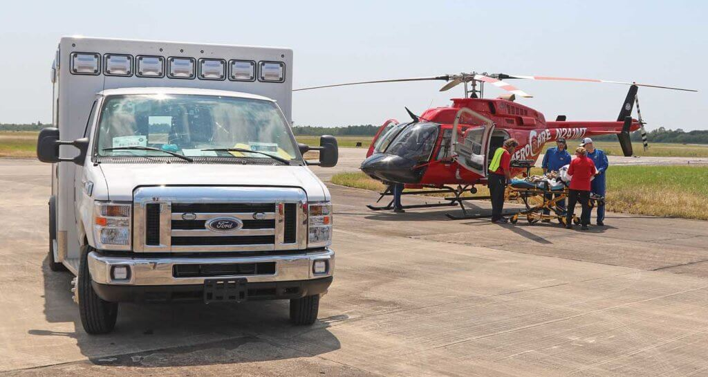 An AeroCare Bell 407 performs a patient transfer at a staging area in Houston. Chris Ebdon Photo