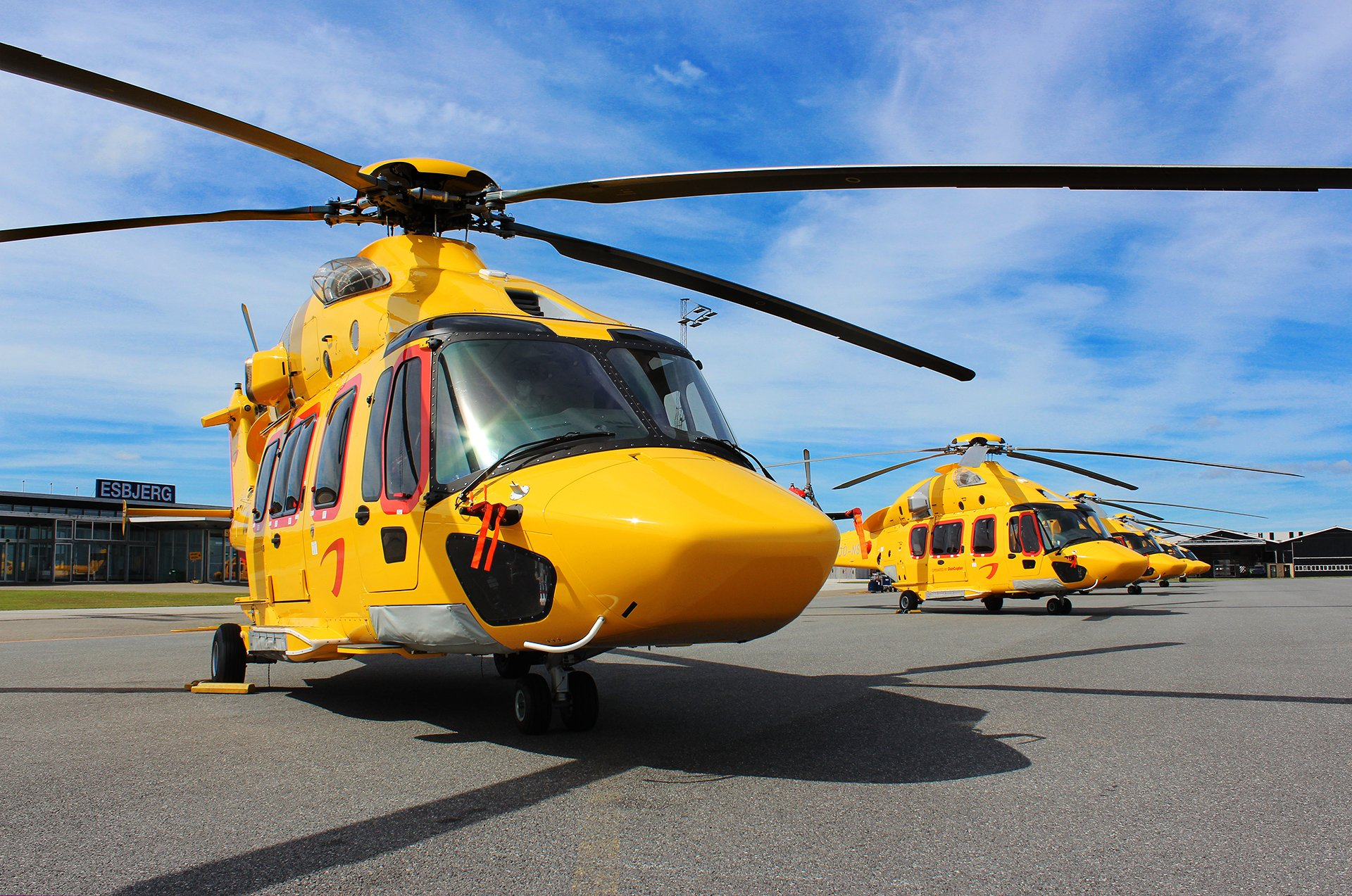 H175 helicopters rest on tarmac