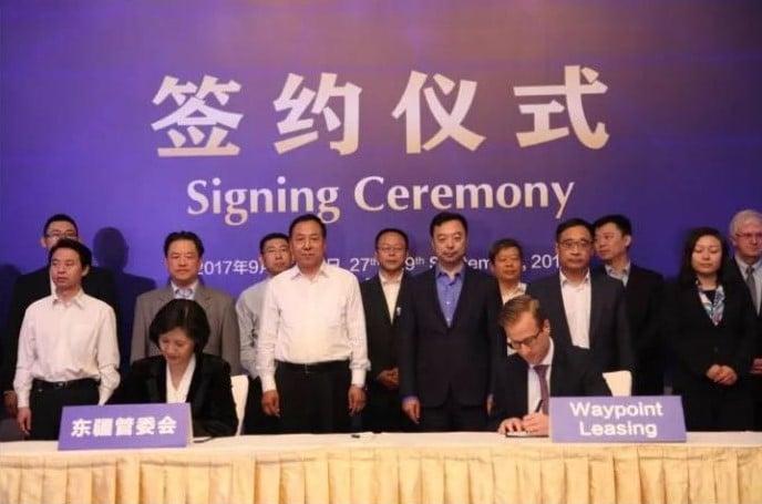 Waypoint's Philip Stransky (right) and Tianjin Free-Trade pilot zone committee director Shen Lei (left) sign a memorandum of understanding to establish a Waypoint leasing platform in Tianjin Free-Trade Zone. Waypoint Leasing Photo