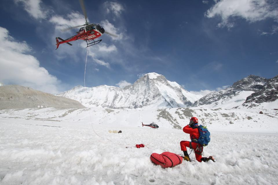 Simrik Air rescue specialist Chhiring Dhenduk Bhote prepares for a long-line rescue mission in the Himalayas. Long-line rescues of climbers are the highest-profile helicopter operations in Nepal, although many more climbers and trekkers are evacuated without long lines. Photo courtesy of Suraj Paudyal