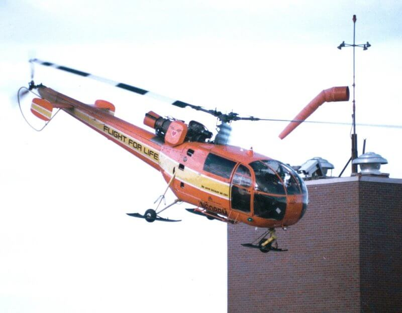 Flight For Life Alouette III lifting from hospital in mid-1980s
