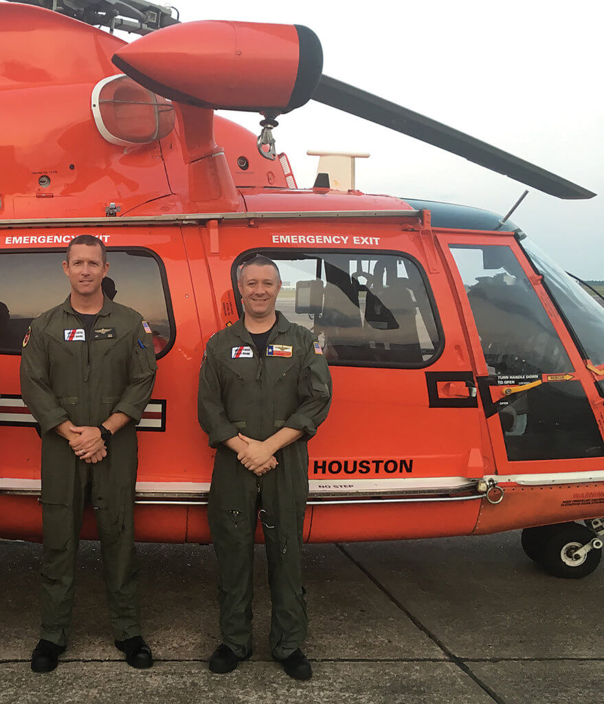 Pilot Lieutenant Commander Joe Heal, left, responded to Harvey from Air Station San Francisco Forward Operating Base Point Mugu, while Lieutenant Daniel Crowley is based at Air Station Houston. Over two days of rescue operations, Heal assisted 18 people and two pets. Crowley, who also serves as the standardization officer for Air Station Houston, took part in 13 rescues. USCG Photo