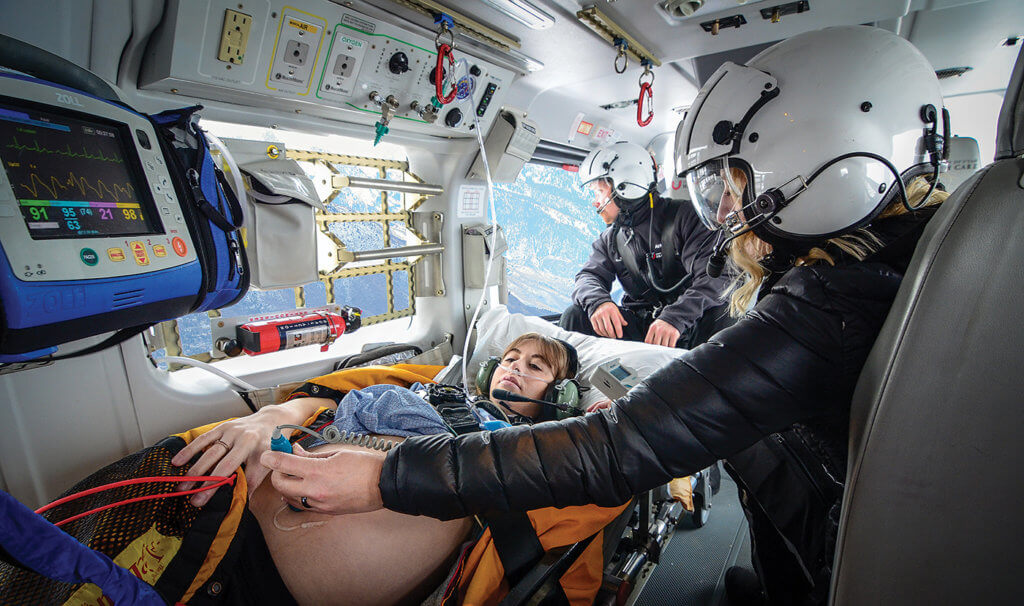 Flight paramedic Jesse Lang (looking out window) and flight nurse Marzena Blundell tend to an OB patient aboard the EC145. Jesse Lang Photo