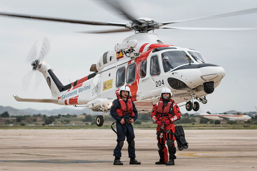 Winch operator Guillermo Penuelas and rescue swimmer Ruben Santamaria stand in front of the AW139 at their base in Valencia. Lloyd Horgan, Vortex Aeromedia Photo