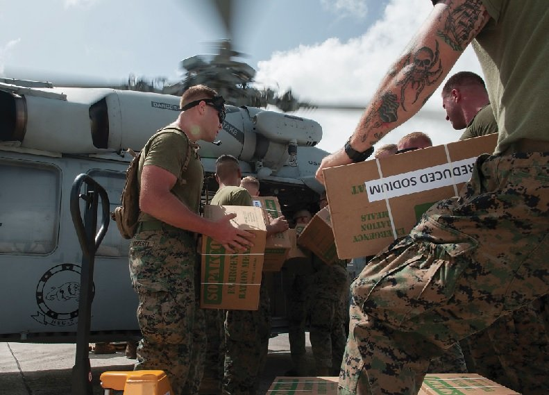 Sailors and Marines load food and water into an MH-60S Sea Hawk helicopter in support of relief efforts in the wake of Hurricane Irma in the U.S. Virgin Islands on Sept. 11. U.S. Navy MC2 Rawad Madanat Photo