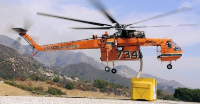 """The S-64 Helitanker is equipped with a 10,000-liter tank capable of snorkeling, via a """"sea snorkel,"""" fresh or salt water that helps provide an outstanding capability for fire authorities in both the initial attack of fast-moving fires and advanced structure protection."""