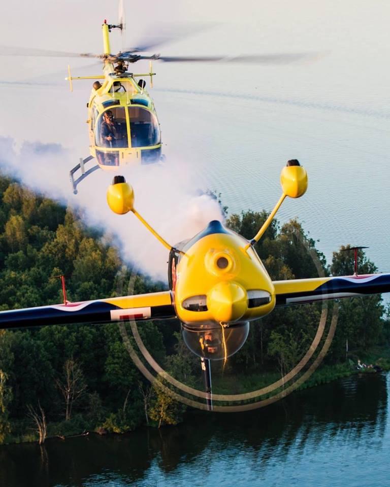 An MBB Bo.105 chases a Zivko Edge 540 flown by Polish aerobatic pilot Luke Czepiela. Photo by Magda Gruszczynska, submitted by Instagram user @lc_aerobatics using hashtag #verticalmag