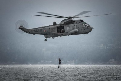 A Royal Canadian Navy diver is hoisted into the Royal Canadian Air Force Sea King Helicopter from 443 Sqn based out of Patricia Bay, British Columbia. Photo submitted by Heather Cook