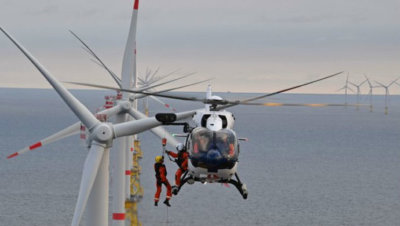 Typical helicopter operations for large offshore wind farms involve the use of light, twin engine and medium helicopters, either to lower crew onto the turbine from the air or to transfer crew to service vessels with helipads and to offshore platforms or substations. Wiking Helikopter Photo